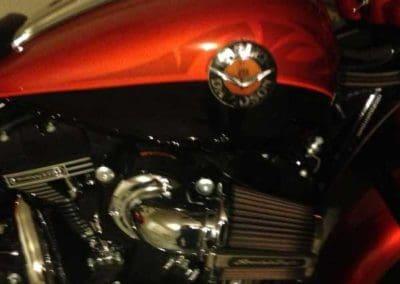 red custom paint job on motorcycle fender